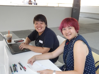 Lynn and Stella are ready to welcome our guests at the registration booth!